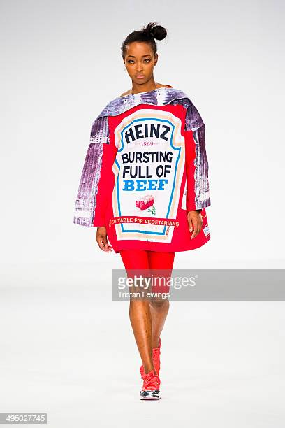 A model walks the runway wearing designs by Eujean Cha during the UCA Epsom show during day 2 of Graduate Fashion Week 2014 at The Old Truman Brewery...