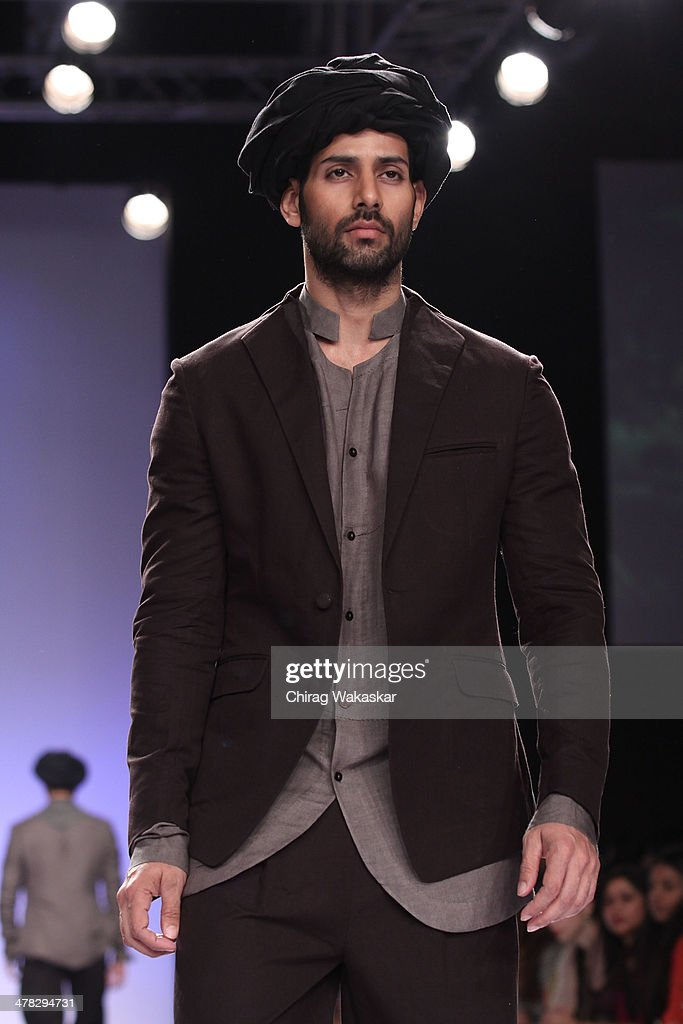 A model walks the runway wearing designs by Gen Next designers at day 2 of Lakme Fashion Week Summer/Resort 2014 at the Grand Hyatt on March 12, 2014 in Mumbai, India.