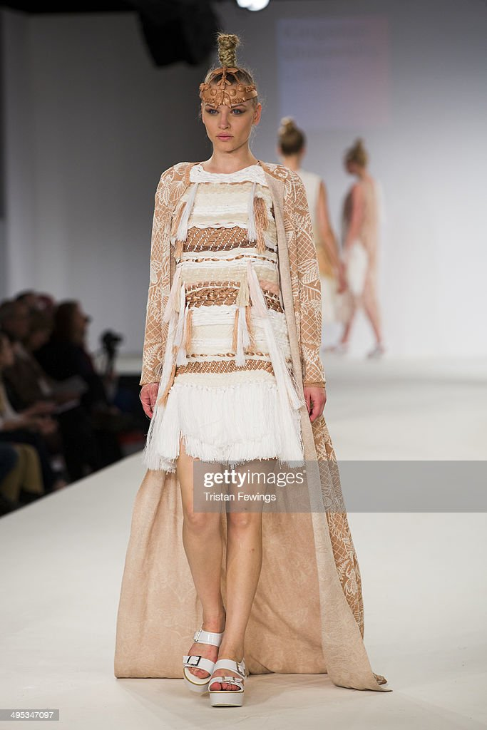 A model walks the runway wearing designs by Jessica Sharp during the Kingston University show during day 3 of Graduate Fashion Week 2014 at The Old Truman Brewery on June 2, 2014 in London, England.