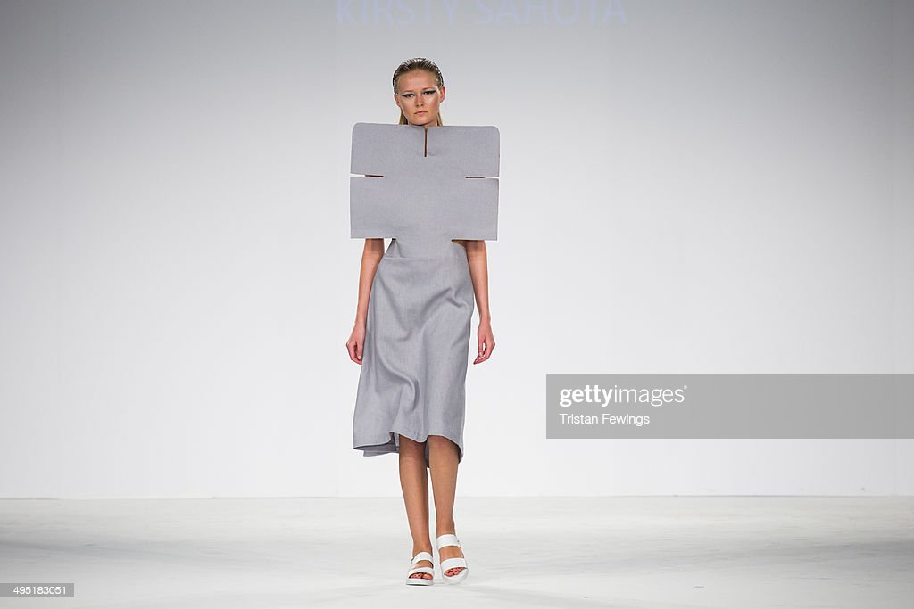 A model walks the runway wearing designs by Kirsty Sahota during the UCA Epsom show during day 2 of Graduate Fashion Week 2014 at The Old Truman Brewery on June 1, 2014 in London, England.