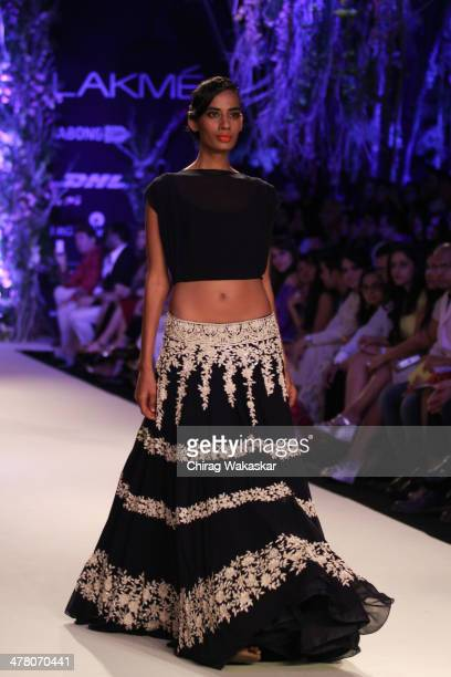 A model walks the runway wearing designs by Manish Malhotra at day 1 of Lakme Fashion Week Summer/Resort 2014 at the Grand Hyatt on March 11 2014 in...