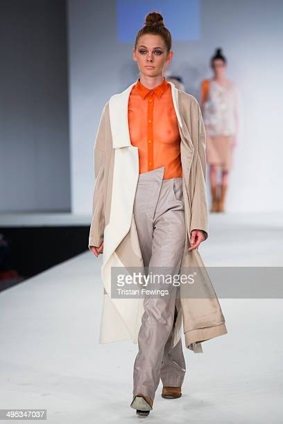 A model walks the runway wearing designs by Maria Brimelow during the Kingston University show during day 3 of Graduate Fashion Week 2014 at The Old...
