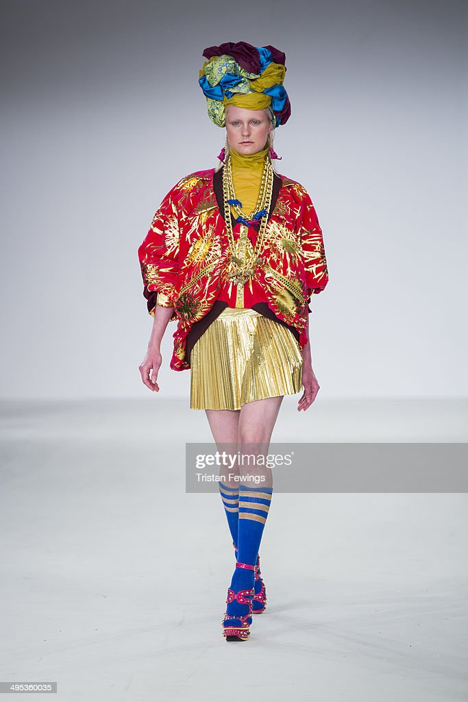A model walks the runway wearing designs by Michael Hone during the Birmingham City University show during day 3 of Graduate Fashion Week 2014 at The Old Truman Brewery on June 2, 2014 in London, England.