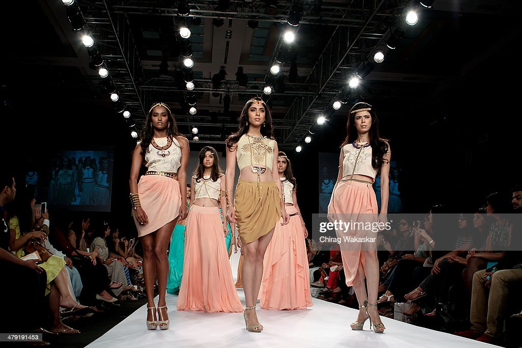 A model walks the runway wearing designs by Pretty Stoned at Lakme Fashion Week Summer/Resort 2014 at the Grand Hyatt on March 16, 2014 in Mumbai, India.