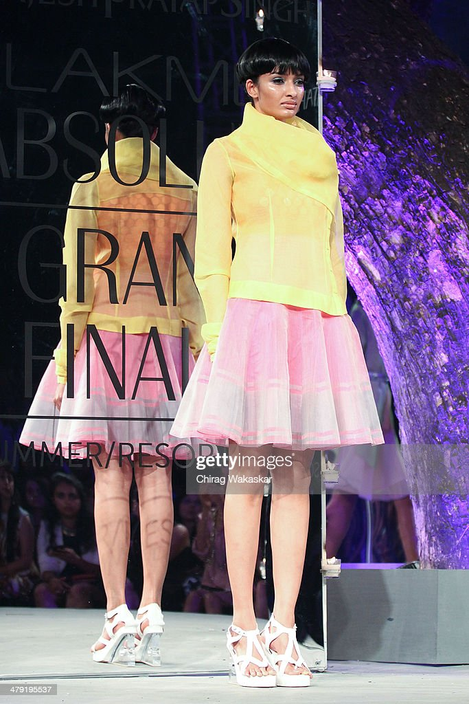 A model walks the runway wearing designs by Rajesh Pratap Singh at the Grand Finale of Lakme Fashion Week Summer/Resort 2014 at the Grand Hyatt on March 16, 2014 in Mumbai, India.