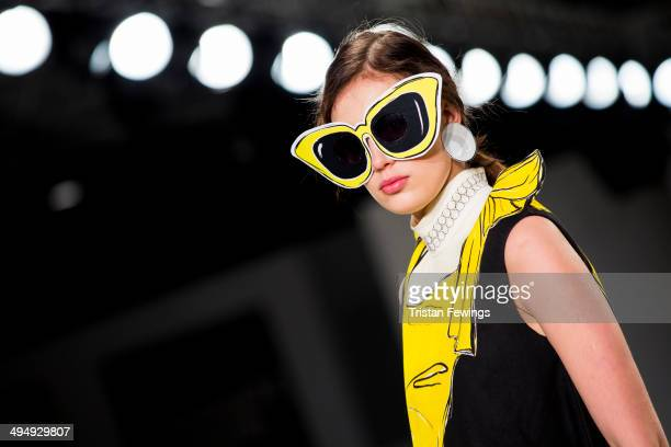 A model walks the runway wearing designs by Rebecca Rimmer during the University of Central Lancashire show during day 1 of Graduate Fashion Week...