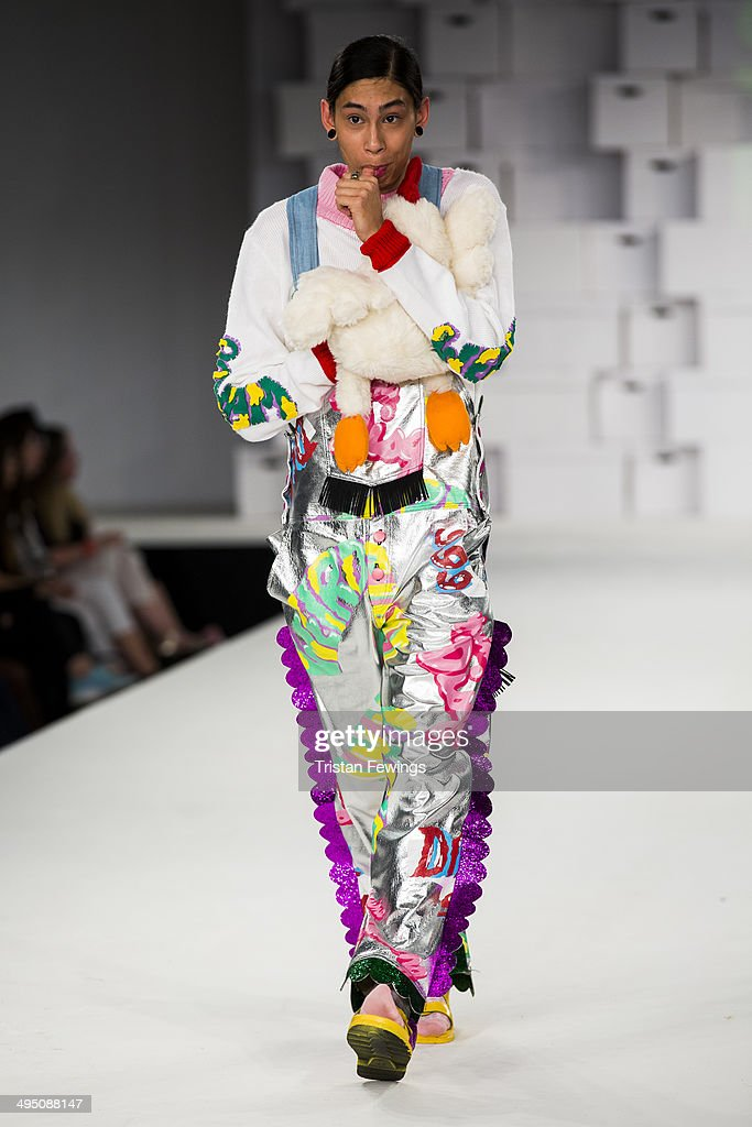 A model walks the runway wearing designs by Sarah Fisher during the Manchester School of Art show during day 2 of Graduate Fashion Week 2014 at The Old Truman Brewery on June 1, 2014 in London, England.