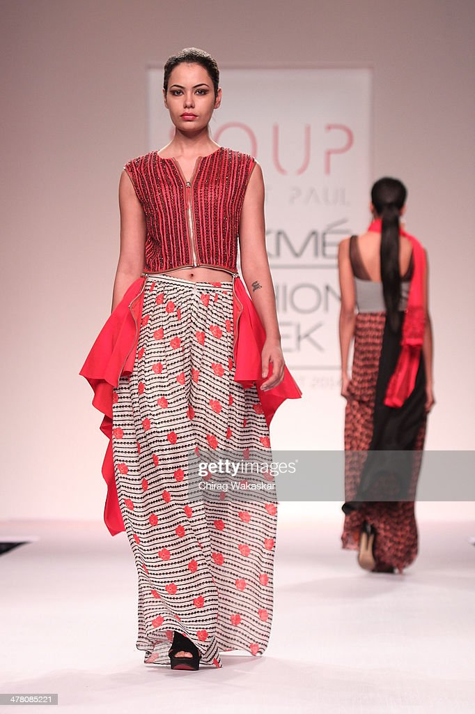 A model walks the runway wearing designs by Sougat Paul at day 2 of Lakme Fashion Week Summer/Resort 2014 at the Grand Hyatt on March 12, 2014 in Mumbai, India.