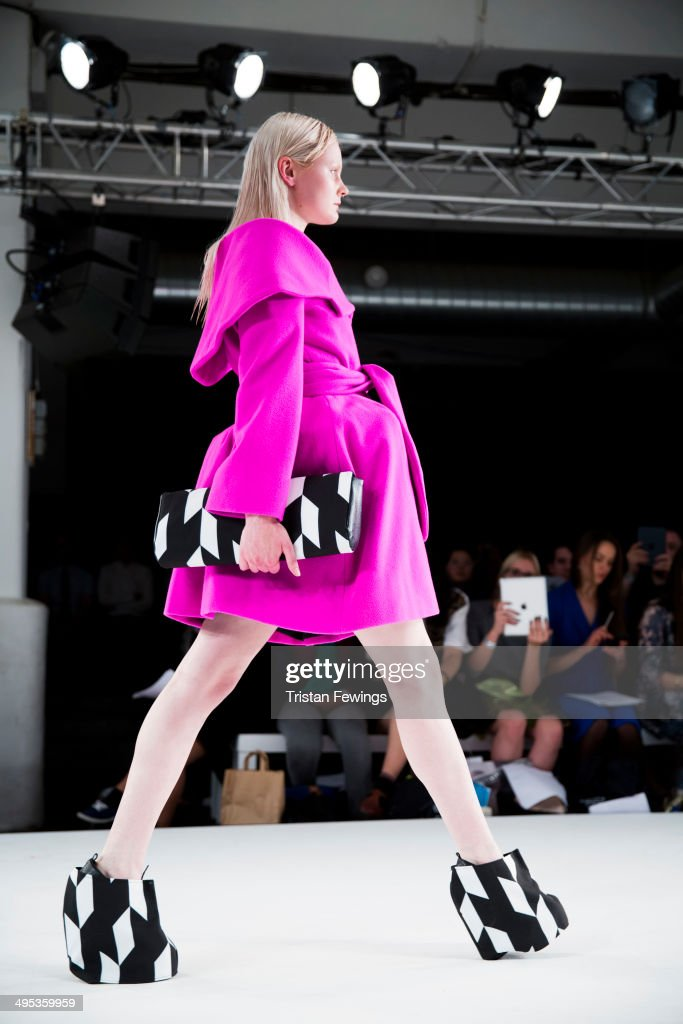 A model walks the runway wearing designs by Stephanie Lee during the Birmingham City University show during day 3 of Graduate Fashion Week 2014 at The Old Truman Brewery on June 2, 2014 in London, England.