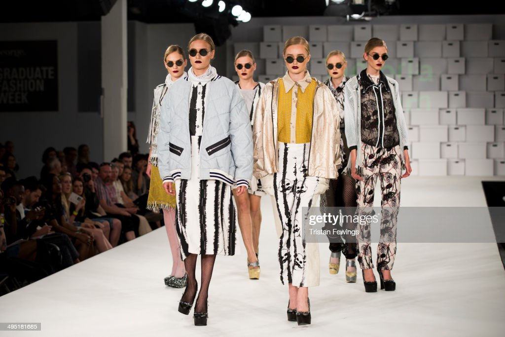 A model walks the runway wearing designs by Victoria Horden during the Manchester School of Art show during day 2 of Graduate Fashion Week 2014 at The Old Truman Brewery on June 1, 2014 in London, England.