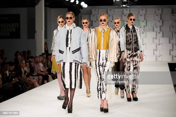A model walks the runway wearing designs by Victoria Horden during the Manchester School of Art show during day 2 of Graduate Fashion Week 2014 at...