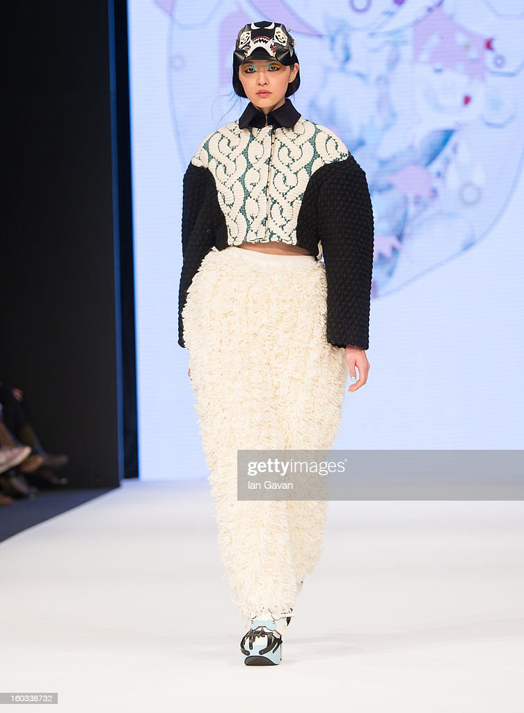A model walks the runway wearing designs by winner Minju Kim during the H&M Design Award at Mercedes-Benz Stockholm Fashion Week Autumn/Winter 2013 at Mercedes-Benz Fashion Pavilion on January 29, 2013 in Stockholm, Sweden.