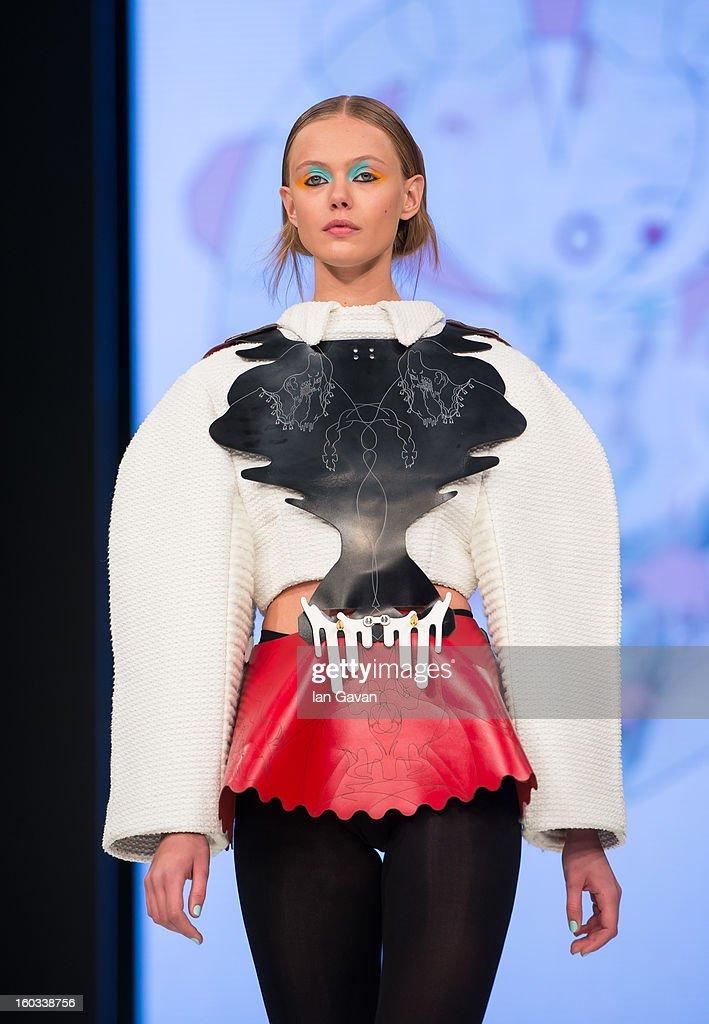 A model walks the runway wearing designs by winner Minju Kim during the H&M Design Award at Mercedes-Benz Stockholm Fashion Week Autumn/Winter 2013 at Mercedes-Benz Fashion Pavilion on January 29, 2013 in Stockholm, Sweden.