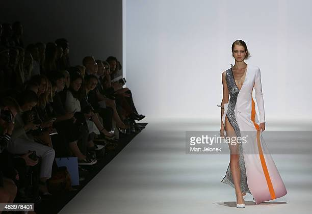 A model walks the runway wearing designs by Yousef Akbar at the Innovators show at MercedesBenz Fashion Week Australia 2014 on April 10 2014 in...