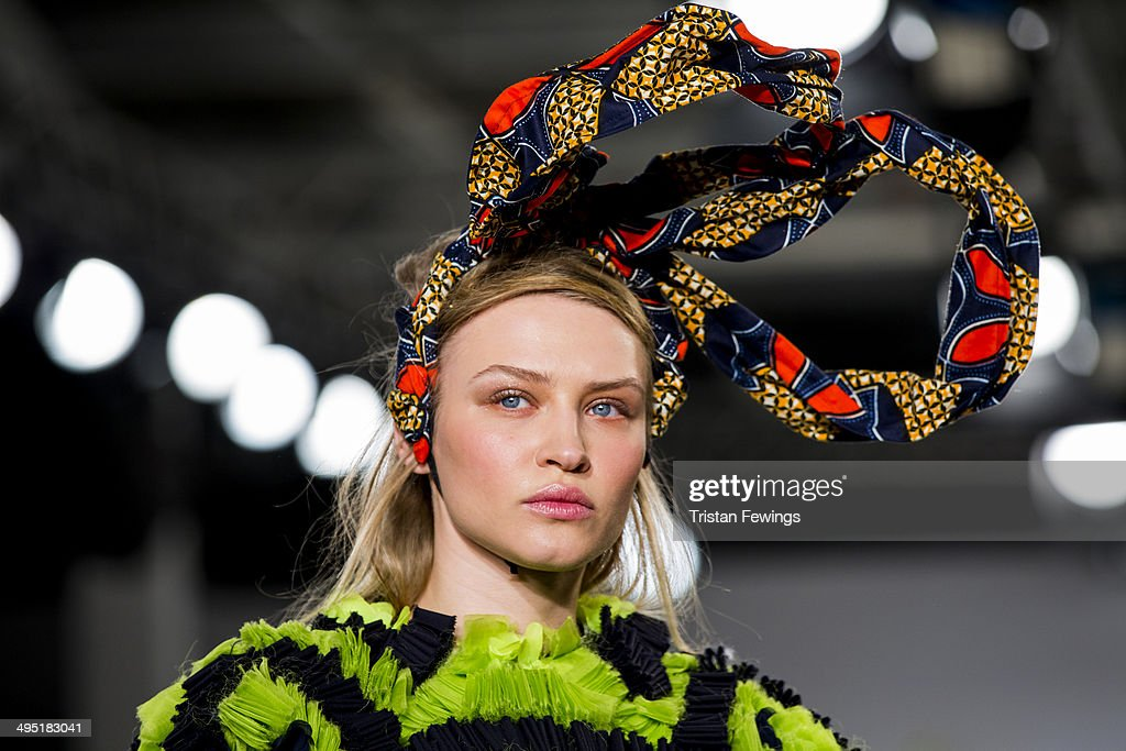 A model walks the runway wearing designs by Zahra Yasmine Azam during the UCA Epsom show during day 2 of Graduate Fashion Week 2014 at The Old Truman Brewery on June 1, 2014 in London, England.