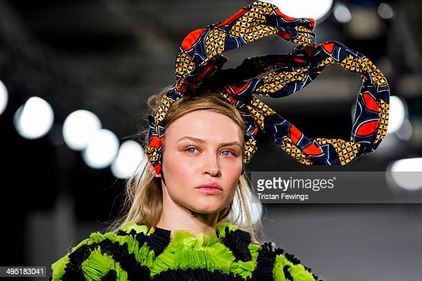 A model walks the runway wearing designs by Zahra Yasmine Azam during the UCA Epsom show during day 2 of Graduate Fashion Week 2014 at The Old Truman...