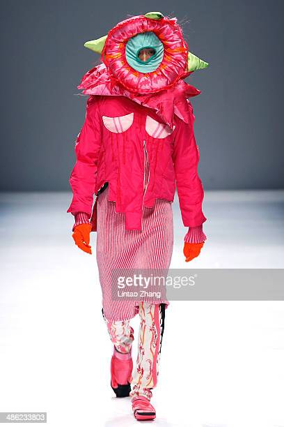 A model walks the runway wearing designs the by China Academy of Art School of Design Graduates Show during the 2014 China Graduate Fashion Week at...