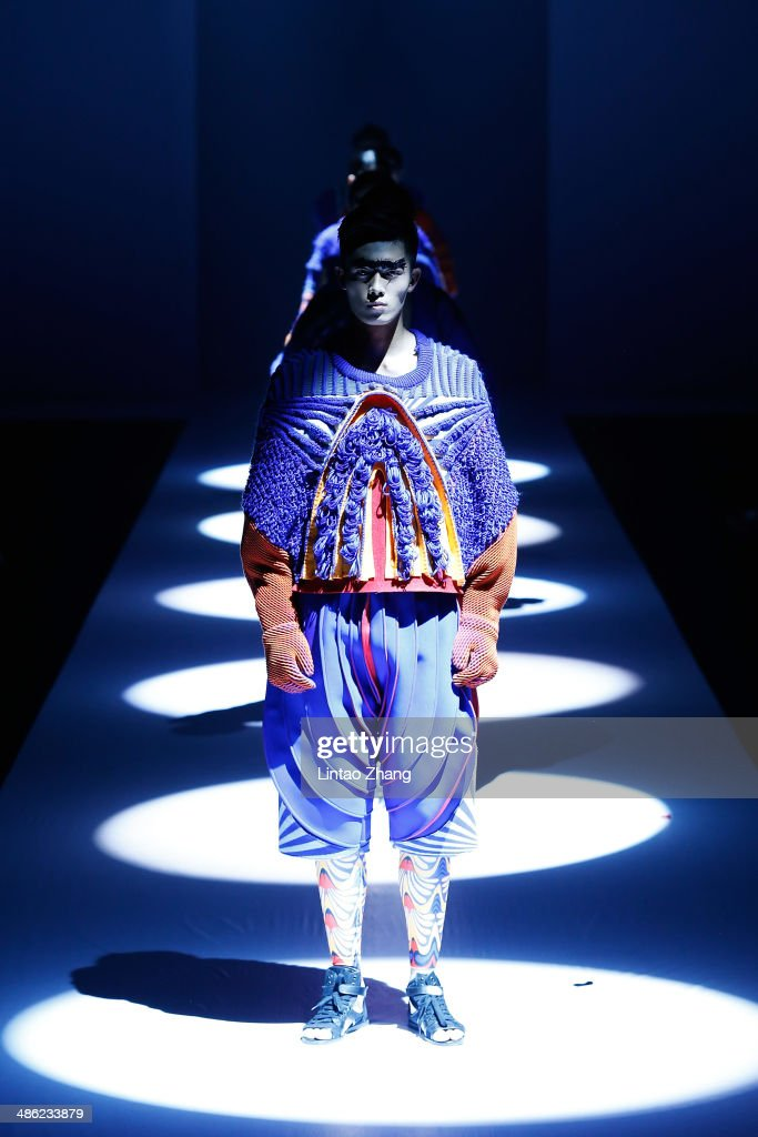 A model walks the runway wearing designs the by China Academy of Art School of Design Graduates Show during the 2014 China Graduate Fashion Week at the 751D-PARK Workshop on April 23, 2014 in Beijing, China.