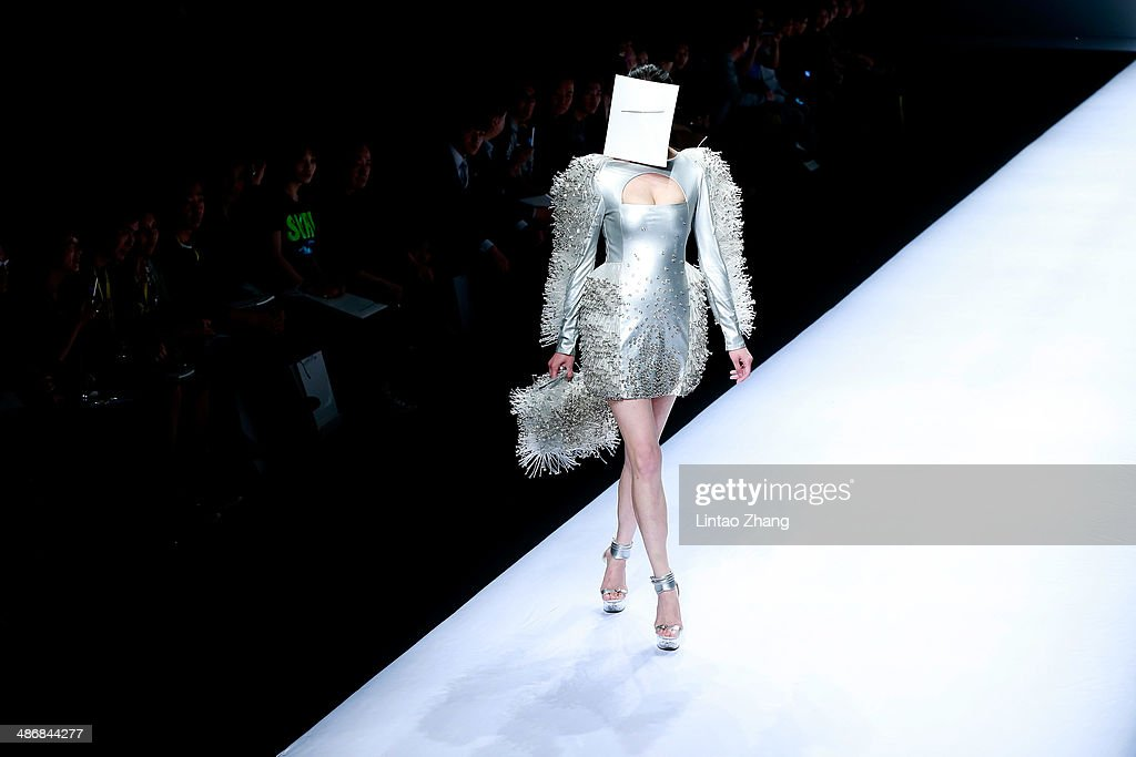 A model walks the runway wearing designs the by Hubei Institute of Fine Arts Graduate Show during the 2014 China Graduate Fashion Week at the 751D-PARK Work shop on April 26, 2014 in Beijing, China.