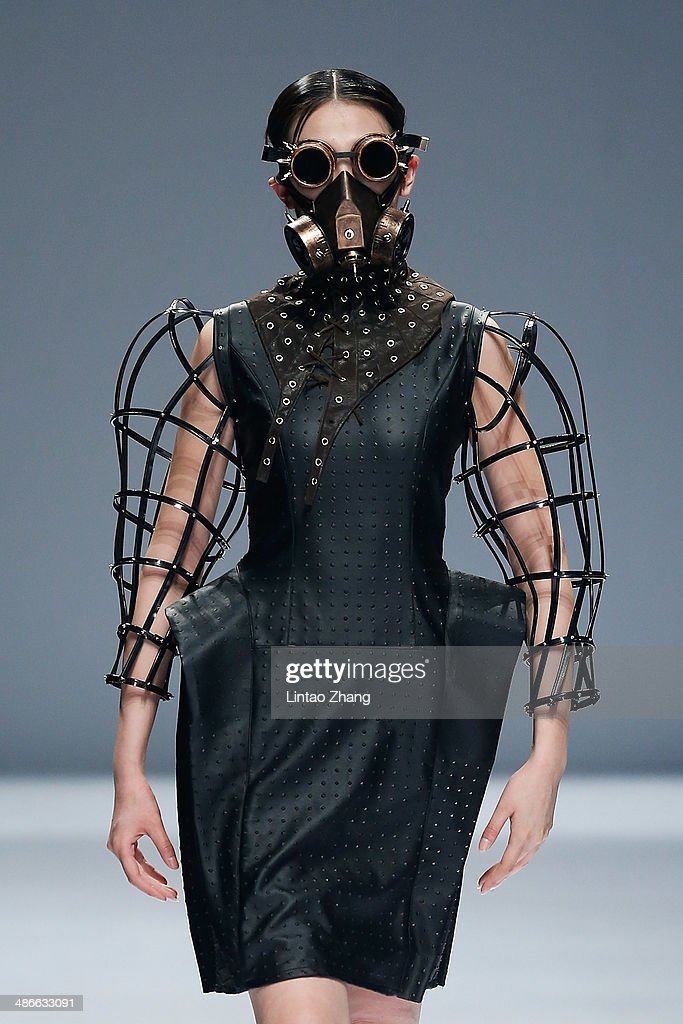A model walks the runway wearing designs the by Zhejiang University of Science and Technology School of Apparel Design Graduates Show during the 2014 China Graduate Fashion Week at the 751D-PARK Workshop on April 25, 2014 in Beijing, China.