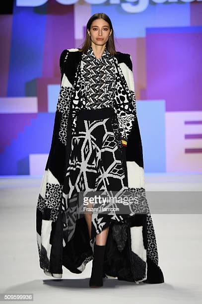 A model walks the runway wearing Desigual Fall 2016 during New York Fashion Week The Shows at The Arc Skylight at Moynihan Station on February 11...