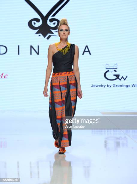 A model walks the runway wearing Dinkra at Los Angeles Fashion Week SS18 Art Hearts Fashion LAFW on October 7 2017 in Los Angeles California