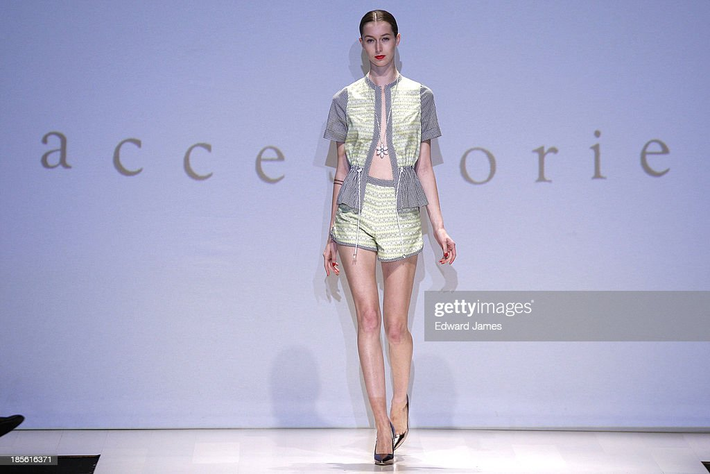 A model walks the runway wearing Dreamboat Lucy during the Mercedes-Benz Startup Finals fashion show at David Pecaut Square on October 22, 2013 in Toronto, Canada.