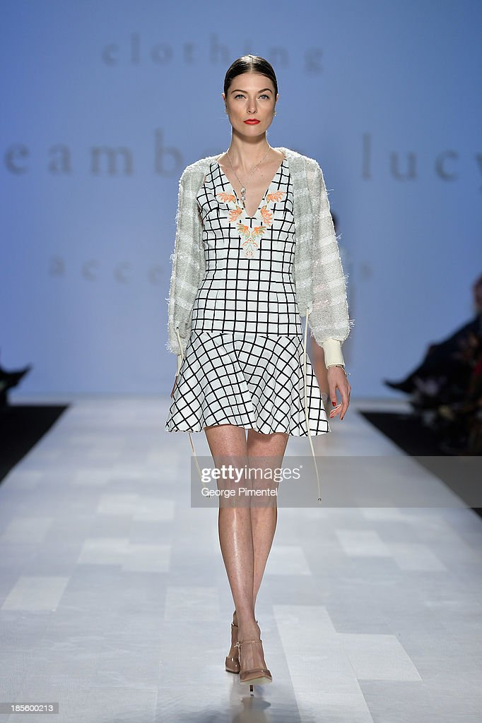 A model walks the runway wearing Dreamboat Lucy spring 2014 collection during the Mercedes-Benz Start-Up national final at World MasterCard Fashion Week Spring 2014 at David Pecaut Squareon October 22, 2013 in Toronto, Canada.