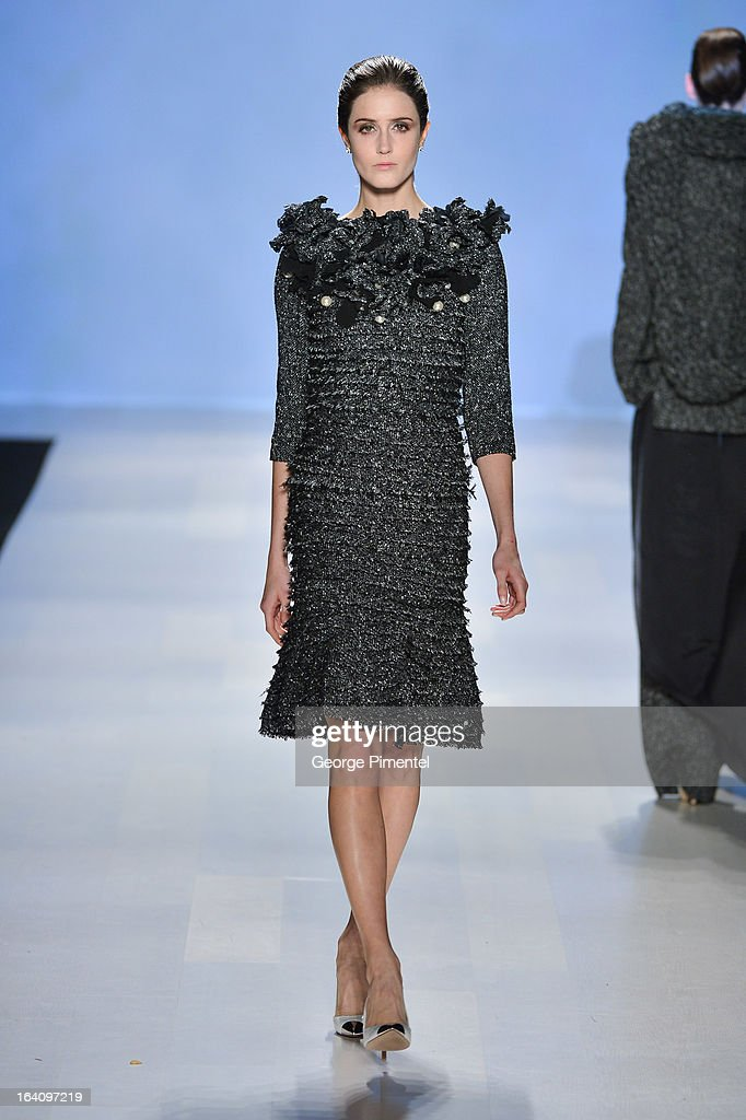 A model walks the runway wearing DUY fall 2013 collection as part of World MasterCard Fashion Week Fall 2013 at David Pecaut Square on March 19, 2013 in Toronto, Canada.