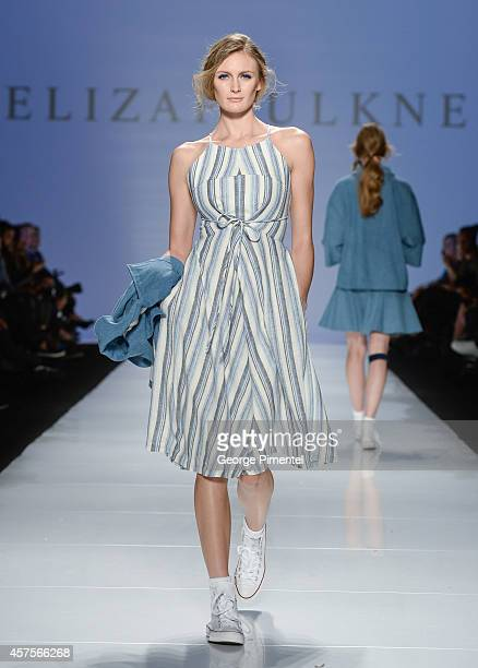 A model walks the runway wearing Eliza Faulkner spring 2015 collection during the MercedesBenz Start Up finals at World MasterCard Fashion Week...