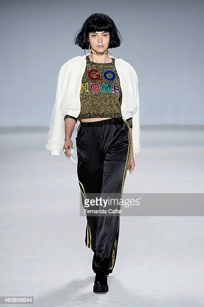 A model walks the runway wearing Fig Viper at the Tokyo Runway Meets New York fashion show during MercedesBenz Fashion Week Fall 2015 at The Salon at...