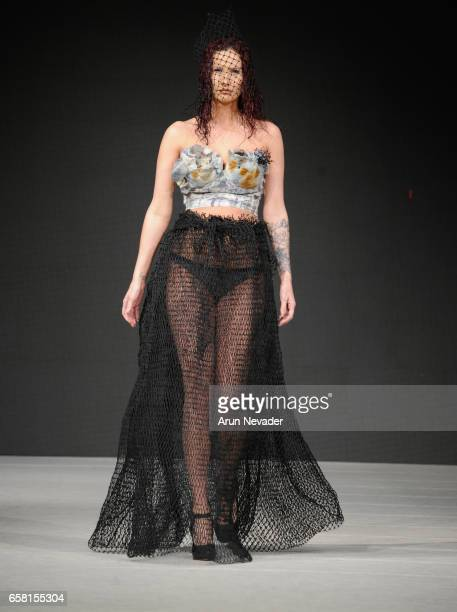 A model walks the runway wearing Green Embassy at Vancouver Fashion Week Fall/Winter 2017 at Chinese Cultural Centre of Greater Vancouver on March 26...