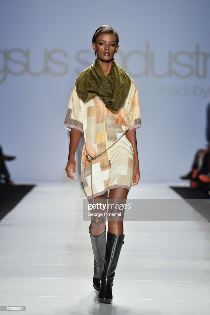 A model walks the runway wearing G-SUS fall 2014 collection during World MasterCard Fashion Week Fall 2014 at David Pecaut Square on March 19, 2014 in Toronto, Canada.