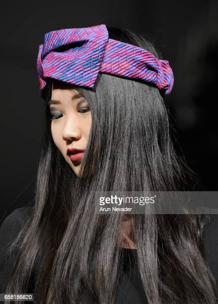 A model walks the runway wearing Hattitude by Christina Lichy at Vancouver Fashion Week Fall/Winter 2017 at Chinese Cultural Centre of Greater...