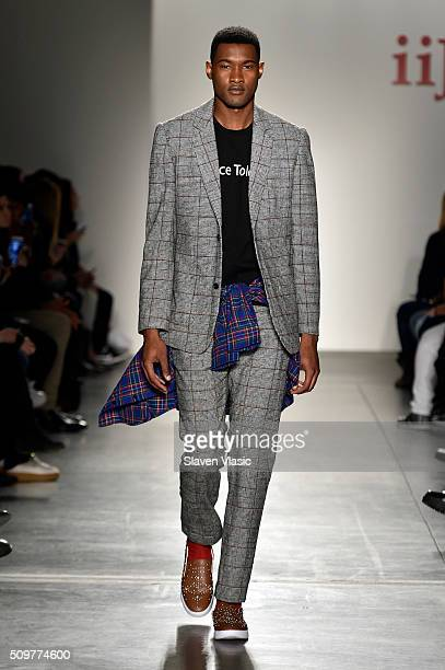 A model walks the runway wearing iiJin Fall 2016 during New York Fashion Week at Pier 59 on February 12 2016 in New York City