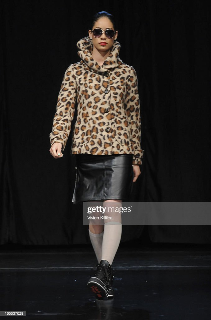 A model walks the runway wearing iiJin's Fall/Winter 2013 'The Love Revolution' Clothing And Footwear Collection Fashion Show at Avalon on April 3, 2013 in Hollywood, California.