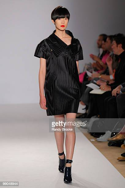 A model walks the runway wearing Isaac Mizrahi Fall 2009 during MercedesBenz Fashion Week at the NY Public Library at 5th Avenue 42nd Street on...