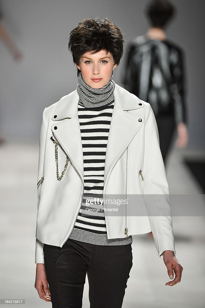 A model walks the runway wearing Joe Fresh fall 2013 collection during World MasterCard Fashion Week Fall 2013 at David Pecaut Square on March 20, 2013 in Toronto, Canada.