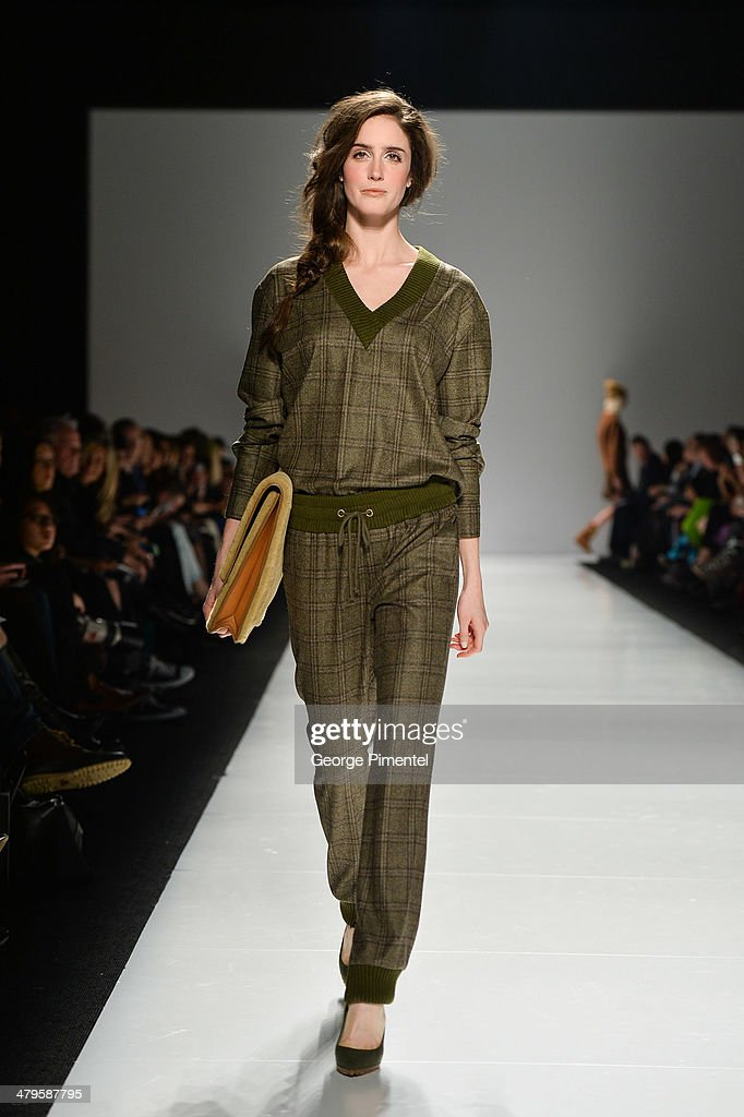 A model walks the runway wearing Joe Fresh fall 2014 collection during World MasterCard Fashion Week Fall 2014 at David Pecaut Square on March 19...