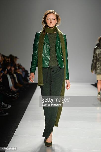 A model walks the runway wearing Joe Fresh fall 2014 collection during World MasterCard Fashion Week Fall 2014 at David Pecaut Square on March 19...