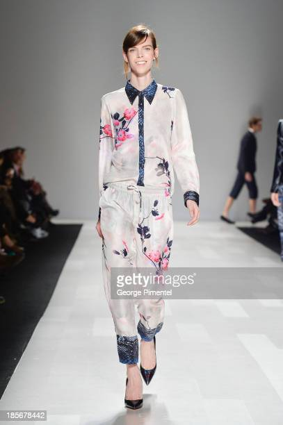 A model walks the runway wearing Joe Fresh spring 2014 collection during World MasterCard Fashion Week Spring 2014 at David Pecaut Square on October...