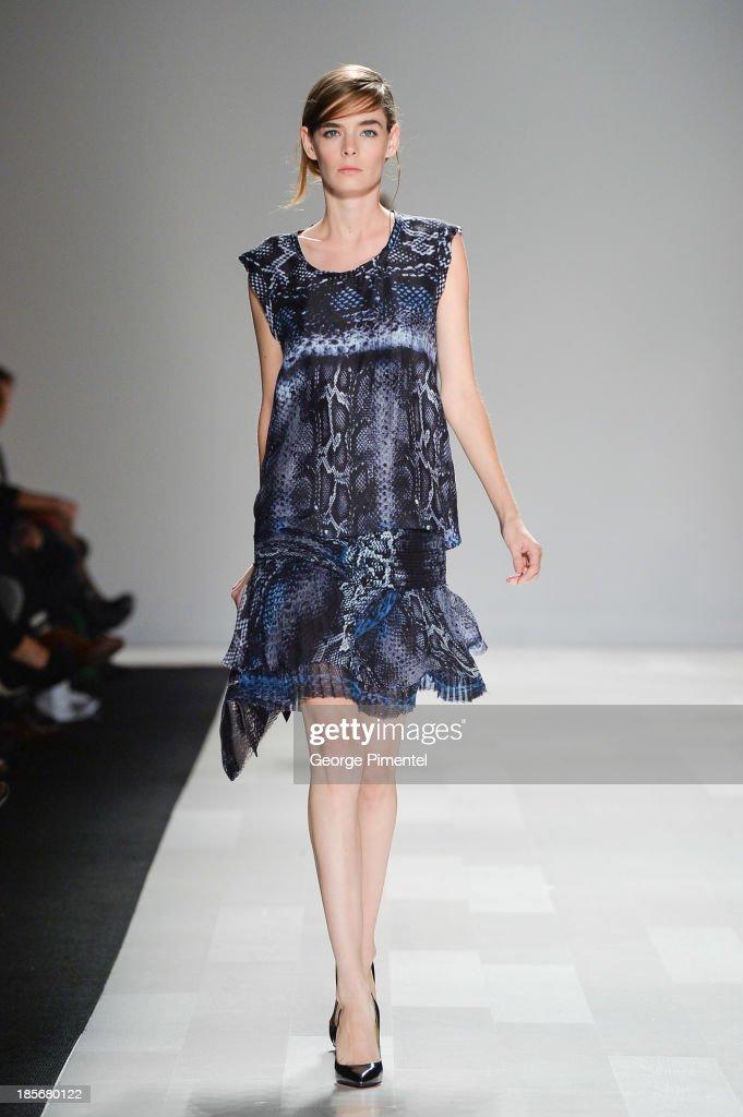 A model walks the runway wearing Joe Fresh spring 2014 collection during World MasterCard Fashion Week Spring 2014 at David Pecaut Square on October...