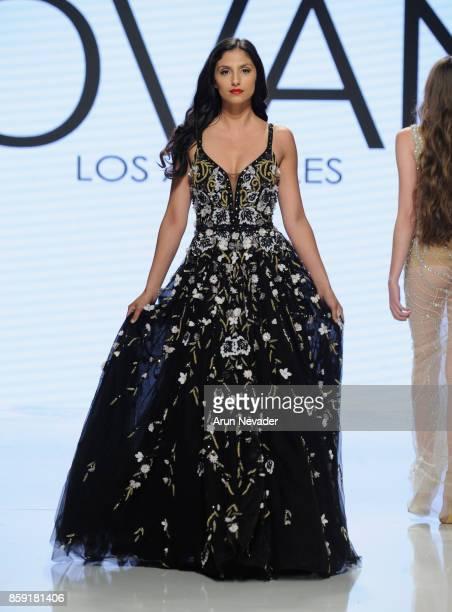 A model walks the runway wearing Jovani La at Los Angeles Fashion Week SS18 Art Hearts Fashion LAFW on October 8 2017 in Los Angeles California