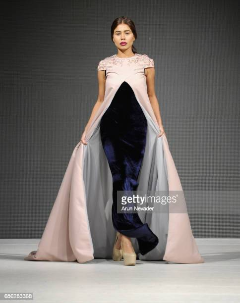 A model walks the runway wearing Karimadon at Vancouver Fashion Week Fall/Winter 2017 at Chinese Cultural Centre of Greater Vancouver on March 21...