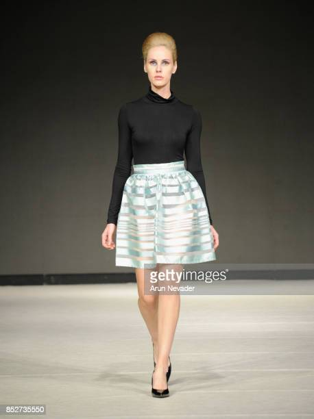 A model walks the runway wearing Katherine Tessier at 2017 Vancouver Fashion Week Day 6 on September 23 2017 in Vancouver Canada