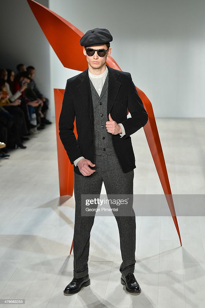 A model walks the runway wearing Klaxon Howl fall 2014 collection during World MasterCard Fashion Week Fall 2014 at David Pecaut Square on March 19...