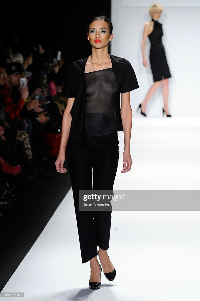 A model walks the runway wearing Kokler at the FLT Moda + Art Hearts Fashion show presented by AIDS Healthcare Foundation during Mercedes-Benz Fashion Week Fall 2014 at The Theatre at Lincoln Center on February 13, 2014 in New York City.