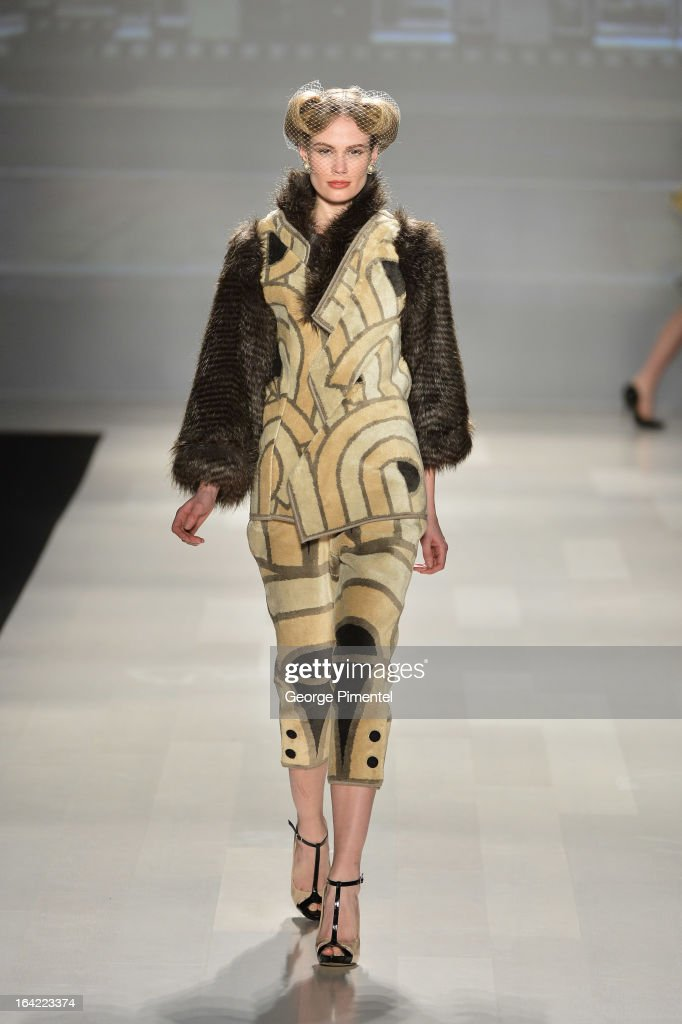 A model walks the runway wearing Korhani fall 2013 collection during World MasterCard Fashion Week Fall 2013 at David Pecaut Square on March 20, 2013 in Toronto, Canada.