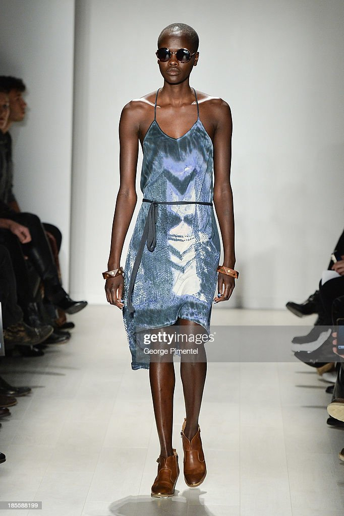 A model walks the runway wearing Laura Siegel spring 2014 collection during World MasterCard Fashion Week Spring 2014 at David Pecaut Square on October 22, 2013 in Toronto, Canada.