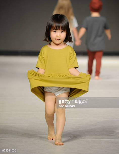A model walks the runway wearing Lil Haven Co at 2017 Vancouver Fashion Week Day 7 on September 24 2017 in Vancouver Canada